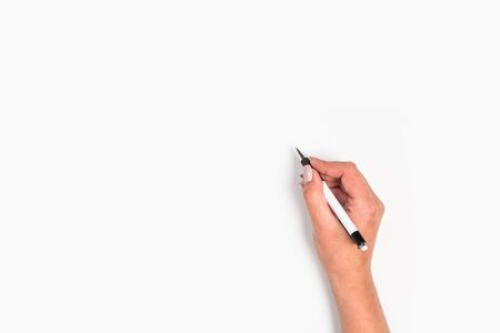 Photo pour Female hands hold a pen. Isolated on white background. copy space, template. - image libre de droit