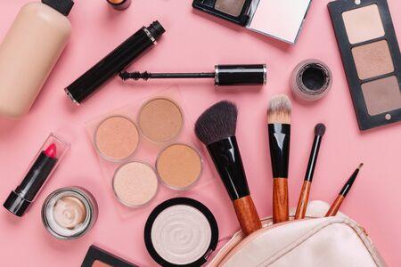 Photo for set of decorative cosmetic powder, concealer, eye shadow brush, blush, foundation on pink background - Royalty Free Image