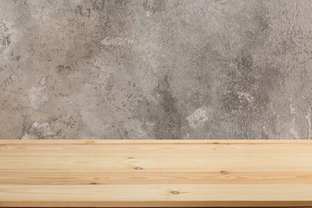 Photo for Wooden board empty table in front of a blurred background. Perspective brown wood with blurry grunge or old wall backdrop - can be used to showcase or mount your products. Mock up  - Royalty Free Image