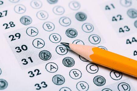 Photo pour pencil for the exam. printed school test Answer sheet - image libre de droit