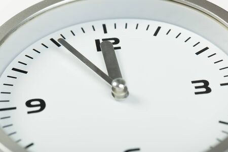 Foto de white with light metal minimalistic wall clock close-up on a light background - Imagen libre de derechos