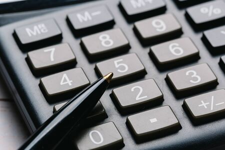 Photo pour black calculator, Business and Finance accounting concept on wooden table - image libre de droit