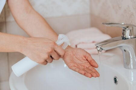 Hygiene concept. Washing hands with soap under the faucet with water
