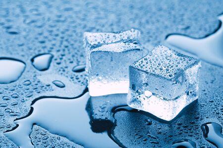 Photo pour Ice cubes square with drops water clean on blue background. - image libre de droit