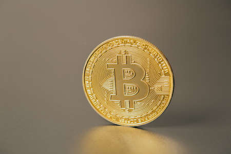 Foto de Bitcoins and new virtual money on plain gray background - Imagen libre de derechos