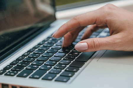 Foto de woman using laptop, searching the internet, viewing information, having a job at home - Imagen libre de derechos