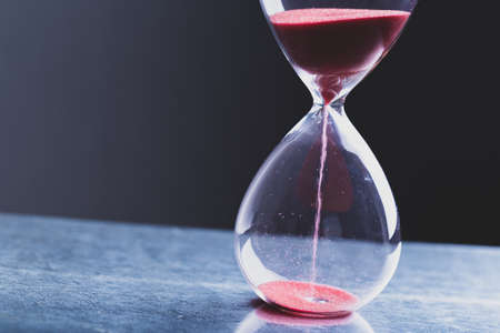Photo pour Hourglass as a concept of passing time for business deadline, urgency and outcome of time. - image libre de droit