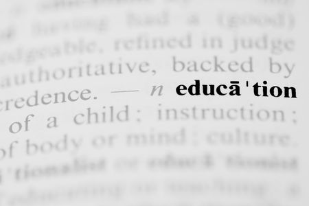 The word education as a dictionary entry in a horizontal photograph.