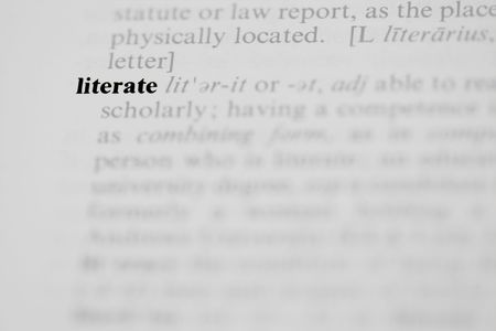The word literate as a dictionary entry in a horizontal photograph.