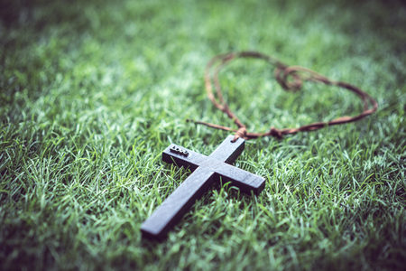 Photo for A mini cross on the grass. - Royalty Free Image