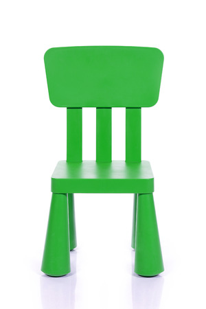 green children plastic chair isolated on white background