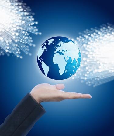 Hand holding globe with fiber optics