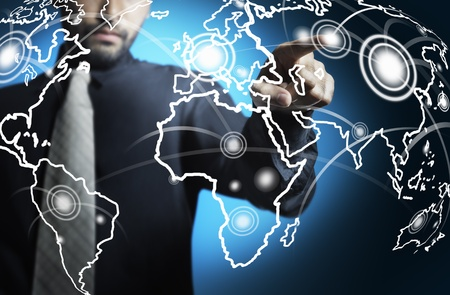 Business man touching world map screen