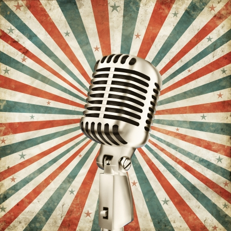 Photo pour vintage microphone on grunge ray background - image libre de droit