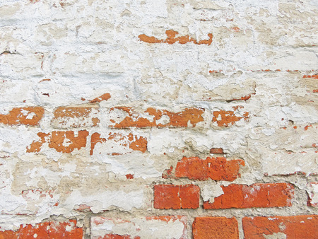 Old Wall of Red Bricks and White Brayed and Cracked Old Paint. Red, Terracotta and White Brick Background.