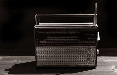 Photo pour Old radio on a black background - image libre de droit