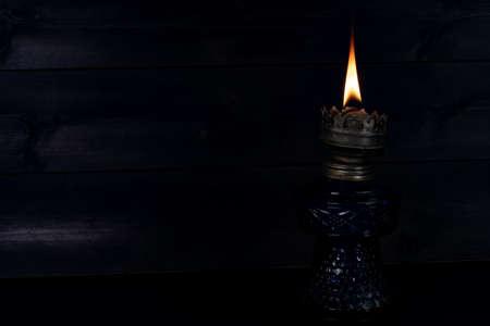 Photo for Kerosene lamp on a wooden background - Royalty Free Image