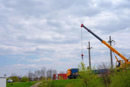 Photo for A crane loads blocks onto a machine - Royalty Free Image