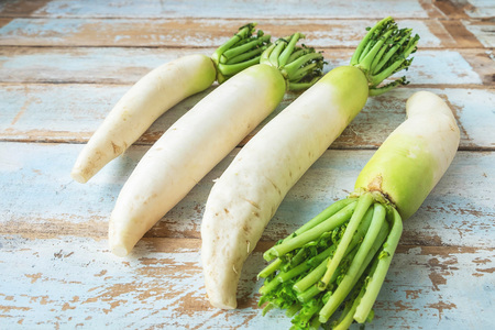 Photo for Radish on a wooden background - Royalty Free Image
