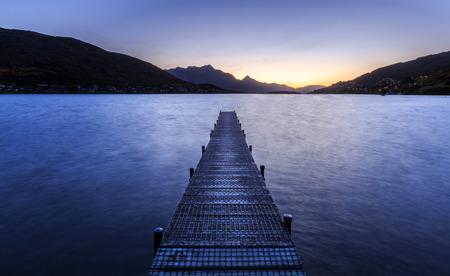 wooden pier on big lake in Queenstown, New Zealand