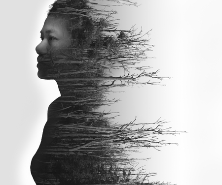 Photo pour Double exposure portrait of young woman and dead forest in black and white - image libre de droit