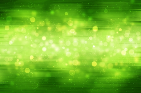 Abstract circular bokeh on green background.