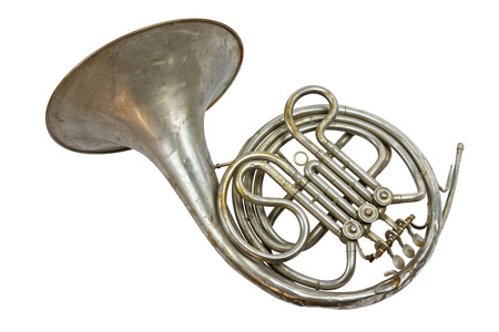 Photo pour Old vintage silver French horn on a white background, isolated - image libre de droit