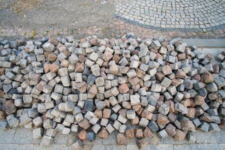 Photo for Color natural stone cubes for making outdoor pavement tiles in the street - Royalty Free Image