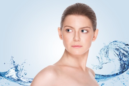 Beautiful girl with clean skin on a background of splashing water
