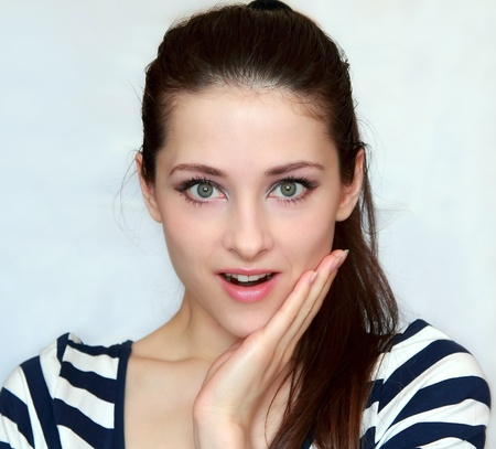 Photo for Surprised happy smiling young woman closeup portrait  Beautiful cheerful model in her 20s  - Royalty Free Image