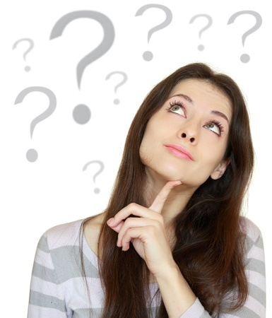 Foto de Thinking beautiful woman with question sign under head isolated on white background - Imagen libre de derechos