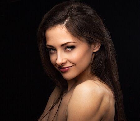 Photo pour Beautiful smiling sexy woman with long hair looking with red lipstick on black background. Closeup portrait. Art.Expression portrait. Vogue - image libre de droit