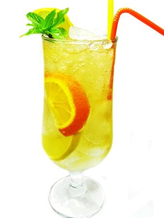 fruit yellow lemonade drink with ice orange lemon and mint