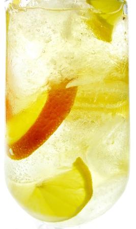 yellow lemonade drink with ice lemon and orange