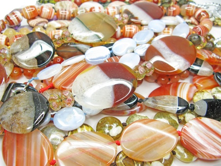 group of colorful semigem beads isolated on white background