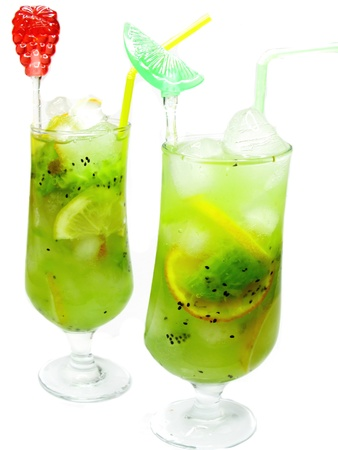 two glasses of fruit green cocktails lemonade with ice and mint
