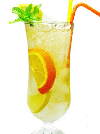 fruit yellow lemonade cocktail with ice and mint