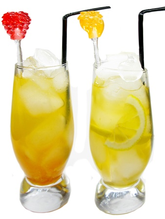 two glasses of fruit juice drinks with ice and lemon
