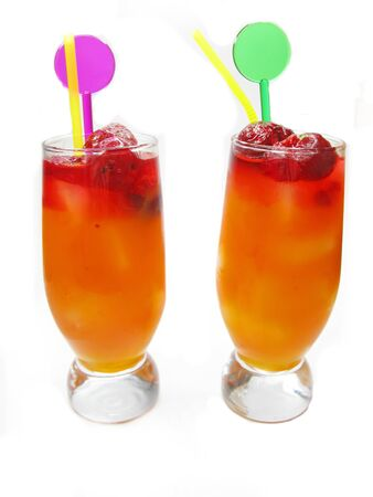 two glasses of red juice drinks with ice and mint