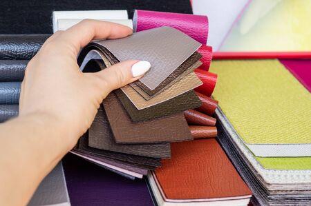 Photo pour Catalog of multicolored imitation leather from matting fabric texture background, leatherette fabric texture. Industry background. - image libre de droit