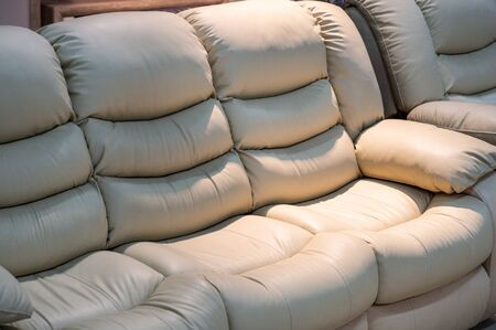 Minimal modern comfortable sofa. Exhibition of sofas and furniture. Furniture store.
