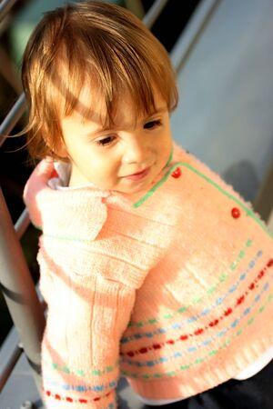 Little girl posing like a real model. Focus on the face.
