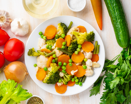 Photo for Mix of boiled vegetables, steam vegetables for dietary low-calorie diet. Broccoli, carrots, cauliflower, top view. - Royalty Free Image