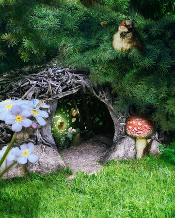 Photo for Forest Fairy in the hut under fir branches. - Royalty Free Image