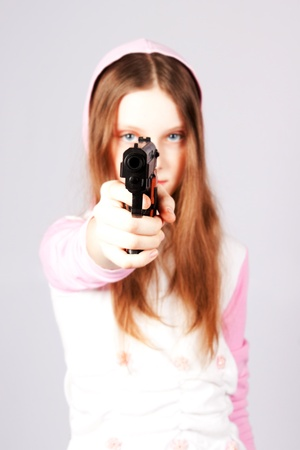 The girl with a pistol.