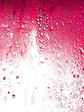 Granadine, fruit soda drops condensation on glass texture background