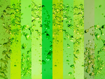 Coloring and energizing water with green glass backgrounds