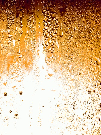 Surface texture of a cold beer glass as background