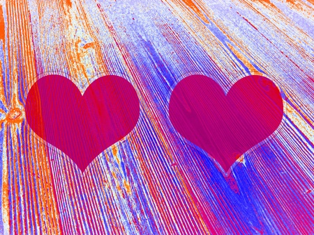 Couple of magenta hearts on lined old wood background