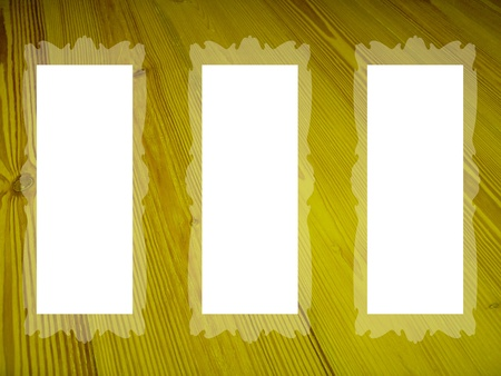 White empty spaces in frames over wood texture in yellow